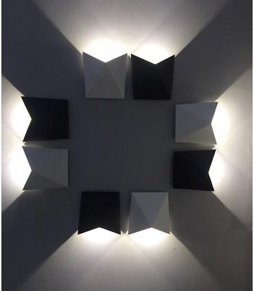 Combinación de apliques Triax blanco y gris oscuro.